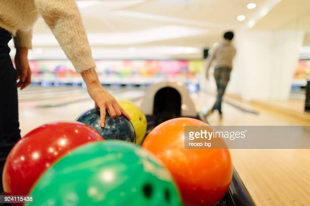 Two people playing bowling