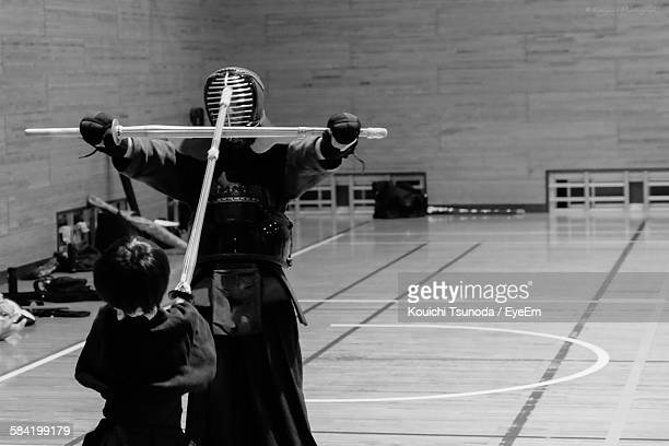 Two People Practicing Kendo