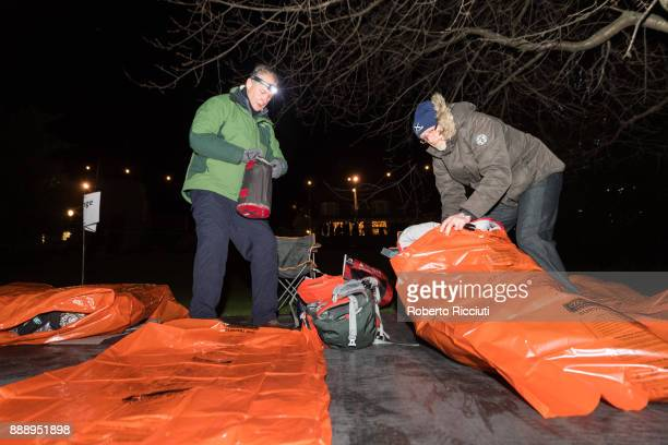 Two people prepare their beds in the garden during Sleep In The Park a Mass Sleepout organised by Scottish social enterprise Social Bite to end...
