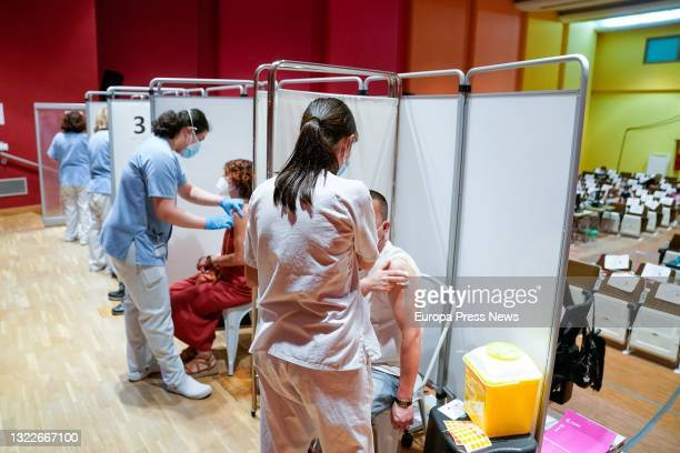 Two people receive the first dose of the Pfizer-BioNTech vaccine against Covid-19, on 9 June, 2021 at the Severo Ochoa Hospital in Leganes, Madrid,...