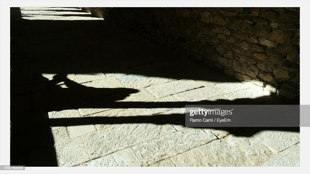 Two People Shadow On Paving Stone In Corridor : Foto stock