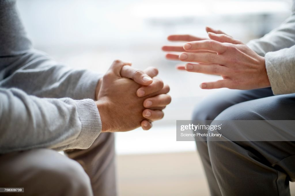 Two people sitting face to face : Stockfoto