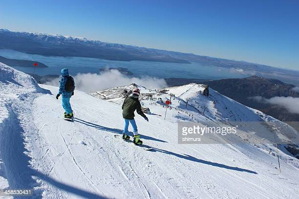 Two people skiing with Gutierrez lake at background - Patagonia