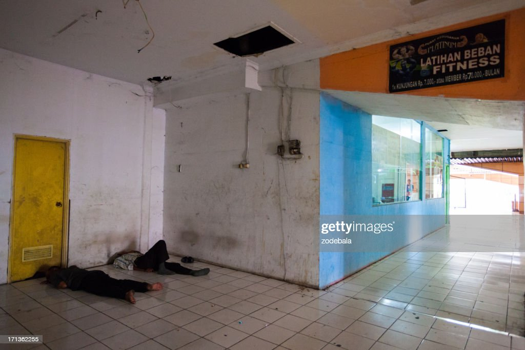 Two People Sleeping On The Floor In Jakarta Indonesia Stock