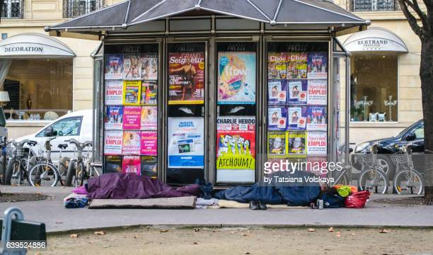 two people sleeping on the street, paris, january 2017 - migrants in paris stock photos and pictures