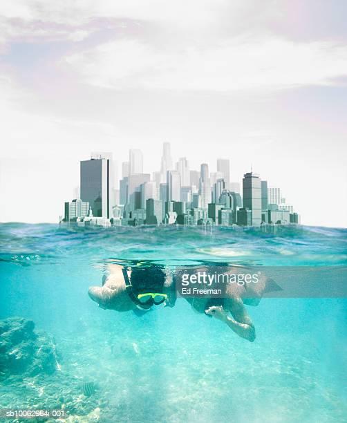 Two people snorkelling in sea (digital Composite)