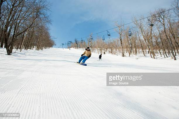 two people snowboarding - roxbury massachusetts stock pictures, royalty-free photos & images