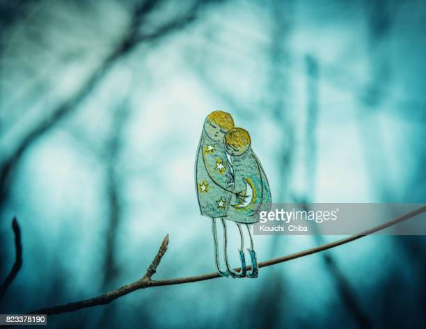 two people snuggle up - kouichi chiba stock photos and pictures