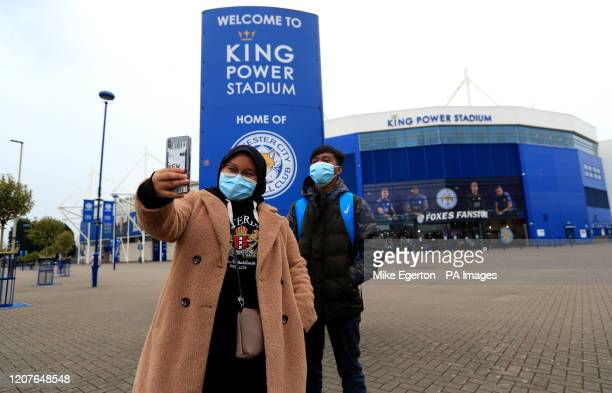 Two people taking a selfie outside the King Power Stadium, home of Leicester City. Premier League clubs will gather via conference call on Thursday...