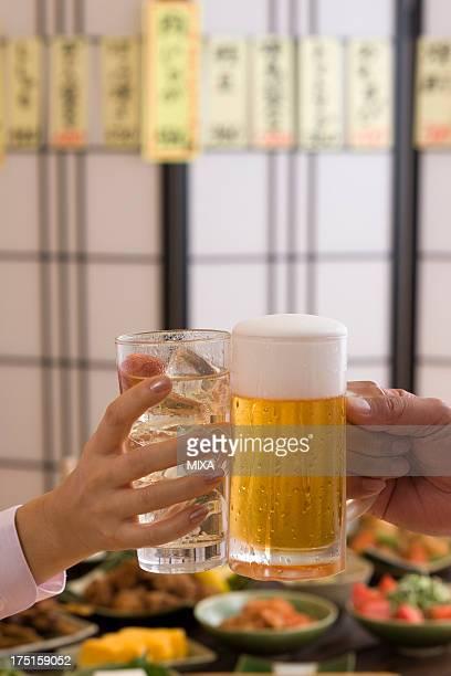 Two People Toasting with Beer and Chu-Hi at Izakaya