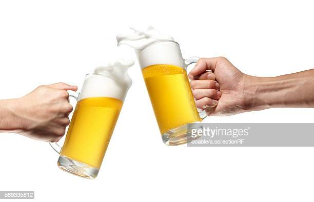 Two People Toasting with Beer