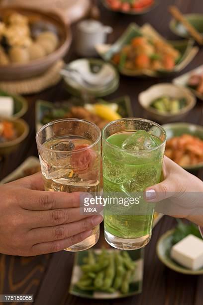 Two People Toasting with Chu-Hi at Izakaya