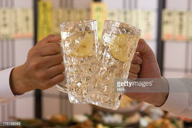 Two People Toasting with Whisky and Soda at Izakaya