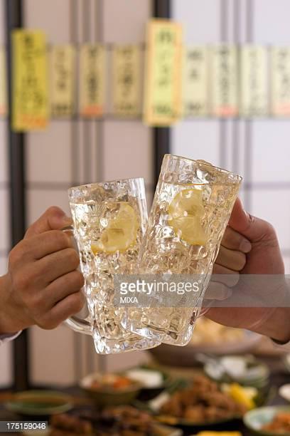 Two People Toasting with Whisky and Soda at Izakaya
