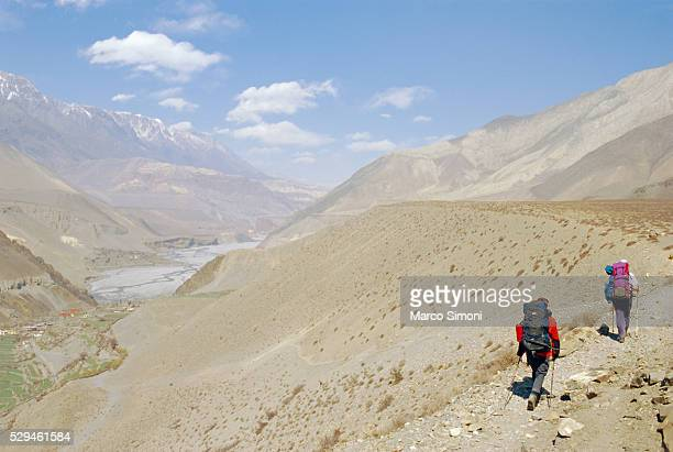 Two people trekking near KaGBeni, Southern Mustang, Nepal