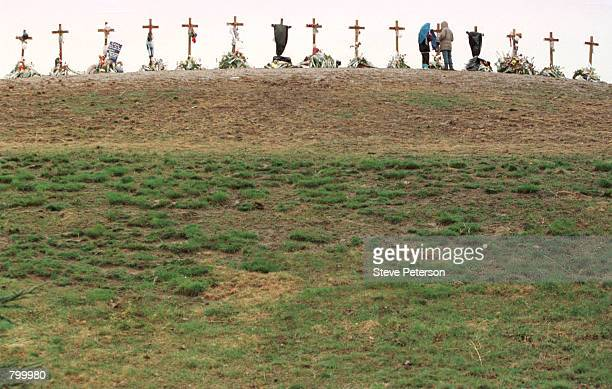 Two people visit a memorial in Clement Park near Columbine High School April 30 1999 in Littleton Colorado The two crosses representing the gunmen...
