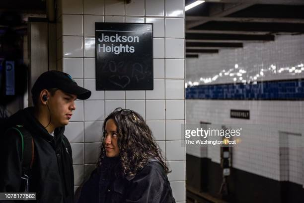 Two people wait for a subway train at the Roosevelt Avenue station Saturday December 15 in Jackson Heights New York It is considered one of the most...