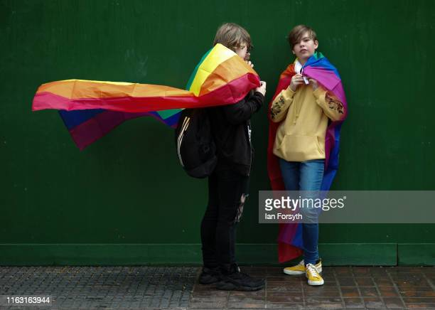 Two people wait to take part in the Newcastle Pride Festival parade on July 20, 2019 in Newcastle upon Tyne, England. To commemorate 50 years since...
