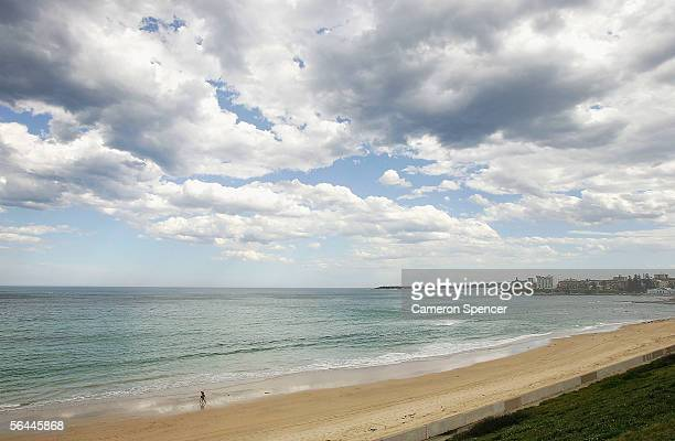 Two people walk along a deserted Cronulla Beach December 17 2005 in Sydney Australia 1500 police are patroling Sydney's Southern beaches following a...