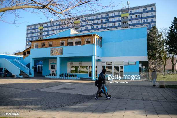 Two people walk past the Muslim cultural centre and mosque as Aydan Ozoguz German Federal Commissioner for Immigration Refugees and Integration...