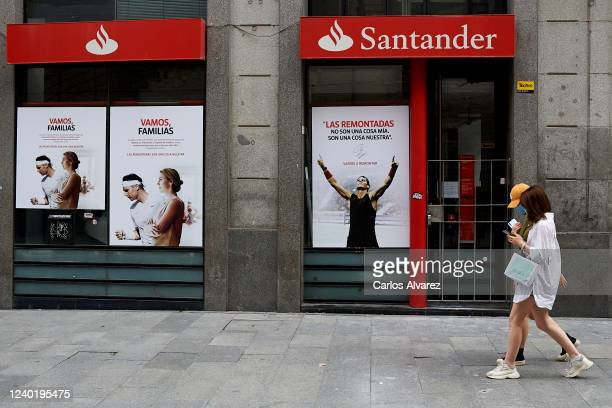 Two people walk past the Santander Bank during phase one of the national plan to reopen the country, on June 01, 2020 in Madrid, Spain. Spain has...