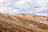 two people walking ridge above hverir