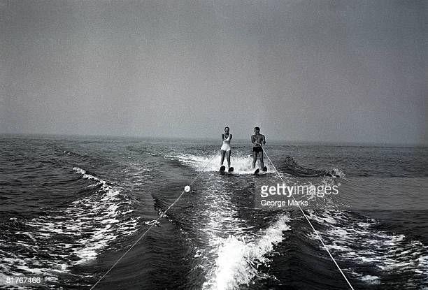 two people waterskiing - waterskiing stock photos and pictures