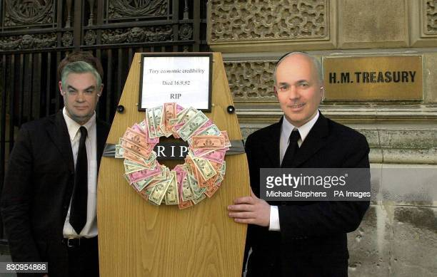 Two people wear masks of Former Tory Chancellor Norman Lamont and Conservative leader Iain Duncan Smith as they hold up a coffin of AntiEuropean...
