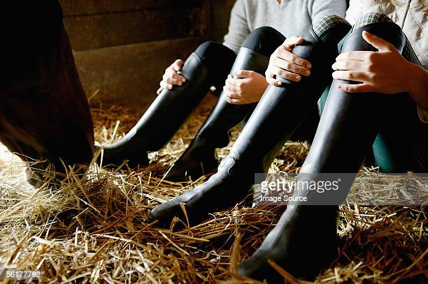 two people wearing riding boots - riding boot stock pictures, royalty-free photos & images