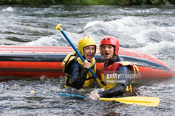 Two people white water rafting