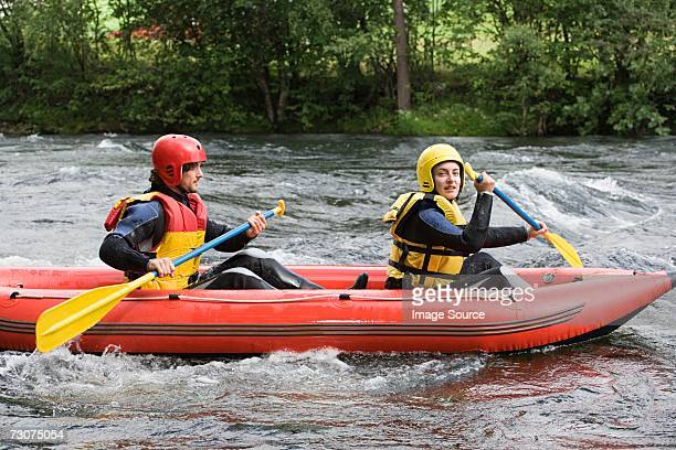 two people white water rafting - ラフティング ストックフォトと画像