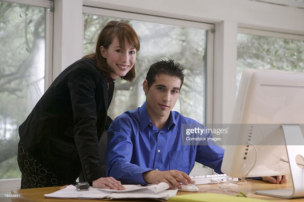 Two people with computer : Stockfoto