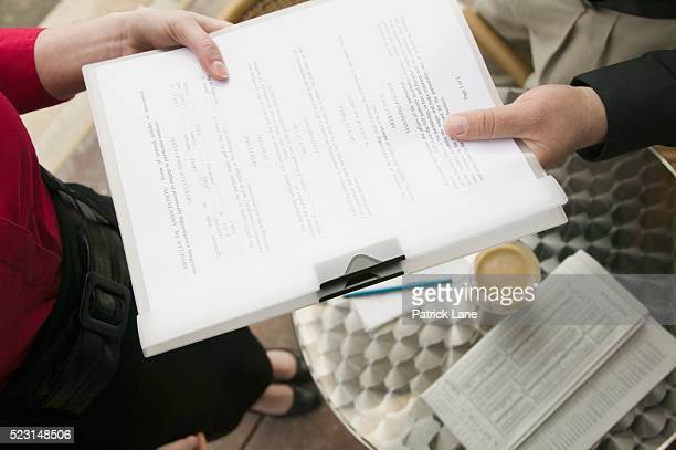 two people with two business documents - patrick grant stock pictures, royalty-free photos & images