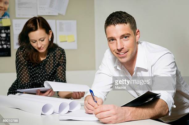 Two people working at desk