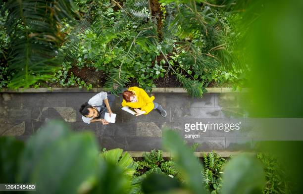 two people working at the botanical garden - balkans stock pictures, royalty-free photos & images