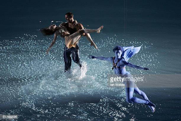 Two performers dance as a performer representing Eros, Archer of Love, from Greek mythology flies overhead during the opening ceremony of the Athens...