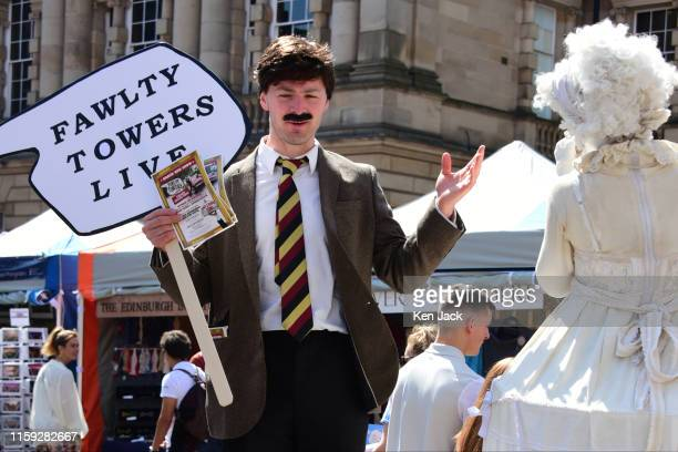 Two performers greet each other as they pass on the Royal Mile as the Edinburgh Festival Fringe gets under way, on August 3, 2019 in Edinburgh,...