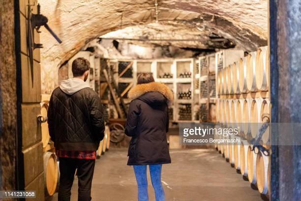 two person visit a traditional cellar. mese, valchiavenna, valtellina, lombardy, italy, europe. - italia stock-fotos und bilder
