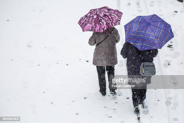 Two person walk during snow fall on March 20 2018 in Berlin Germany