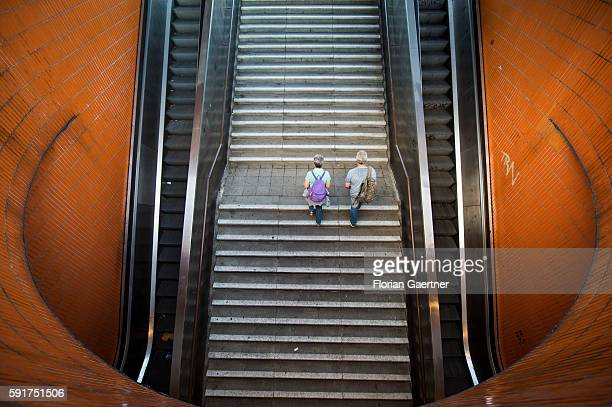 Two persons go upstairs from an underpass on August 17 2016 in Berlin Germany
