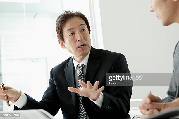 BUSINESS SCENE Two persons in a meeting