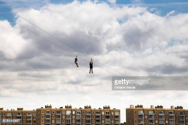 two persons on a zipline