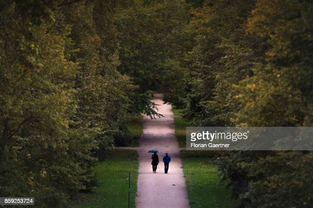 Two persons walk through the park Tiergarten on October 07 2017 in Berlin Germany