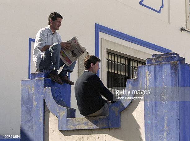 Two persons who live in the town Obidos in Portugal.