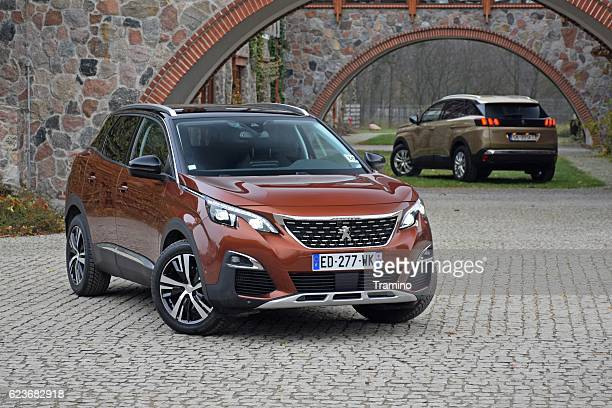 two peugeot 3008 vehicles - psa stock photos and pictures