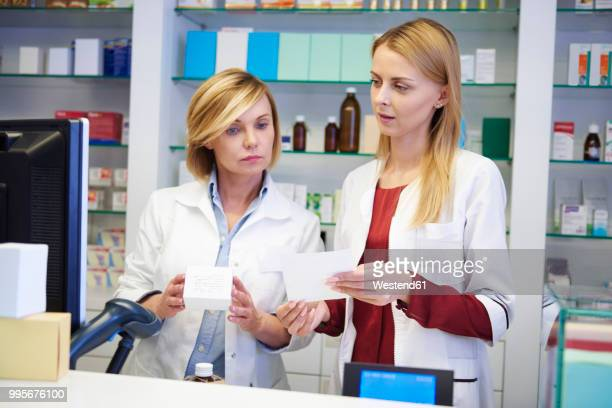 Two pharmacists working together in pharmacy