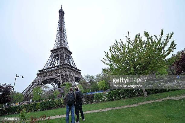 Two photographers take pictures of the Eiffel Tower in Paris April 15 2011