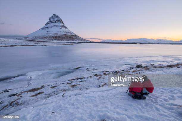 Two Photographers with Kirkjufell mountain in the winter in Iceland