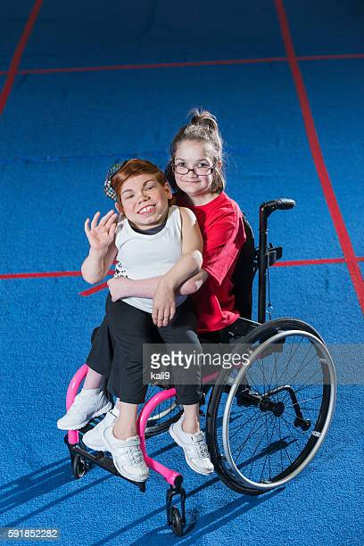 two physically challenged friends - midget stock photos and pictures
