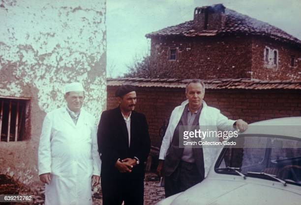 Two physicians stand with the man who was the Index Case for the smallpox epidemic in Kosovo Yugoslavia in March and April of 1972 1972 Image...